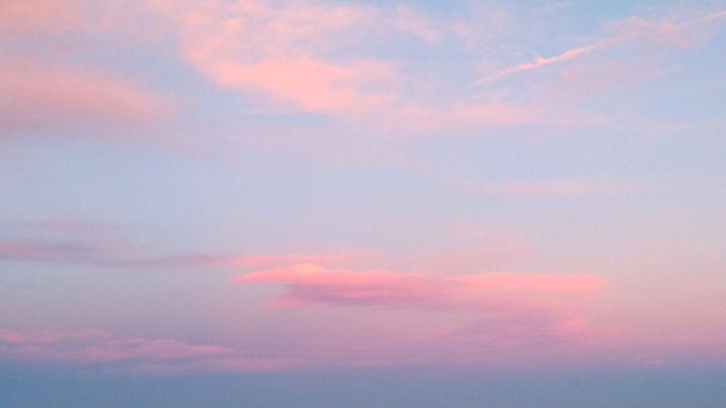 Pink clouds in a blue sky