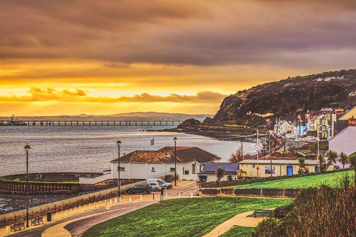 Dramatic yellow sunset behind a coastal town